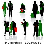 silhouettes of tourists in...