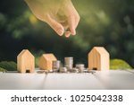 saving to buy a house or home... | Shutterstock . vector #1025042338