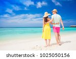 happy young couple walking by... | Shutterstock . vector #1025050156