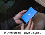 Small photo of CHIANG MAI, THAILAND - FEB 13, 2018 : Man hand holding a Sony xperia mobile phone with Twitter app.Twitter is an online news and social networking service where users post and interact with messages.