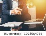 handsome businessman in suit... | Shutterstock . vector #1025064796