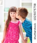 Small photo of Little brother kissing his pretty sister