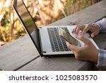 woman used computer and smart...   Shutterstock . vector #1025083570