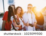 four cheerful young people... | Shutterstock . vector #1025099500