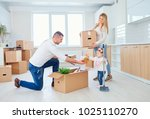 the family with the child moves ... | Shutterstock . vector #1025110270