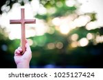 person palm hands to hold holy... | Shutterstock . vector #1025127424