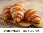 Fresh Croissants On A Wooden...