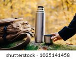 female hand holding cup near... | Shutterstock . vector #1025141458