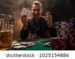handsome poker player with two... | Shutterstock . vector #1025154886