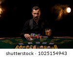 poker player. young guy in the... | Shutterstock . vector #1025154943