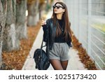 stylish girl walking through...   Shutterstock . vector #1025173420