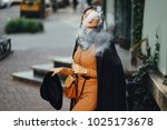 stylish girl smoking an e...   Shutterstock . vector #1025173678