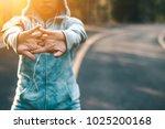 women sport jogging on road in... | Shutterstock . vector #1025200168