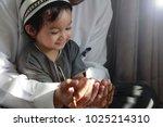 religious asian muslim man... | Shutterstock . vector #1025214310