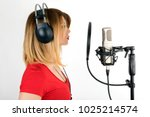 Small photo of Voice acting woman performing a dubbing scene, isolated white background