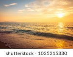 beautiful sunset on the beach... | Shutterstock . vector #1025215330
