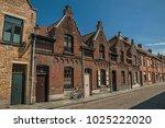 brick facade of houses in... | Shutterstock . vector #1025222020