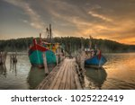two fishing boats at the dock. | Shutterstock . vector #1025222419