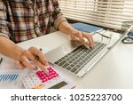 businessman calculate about... | Shutterstock . vector #1025223700