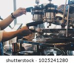 barista making a coffee cup in... | Shutterstock . vector #1025241280