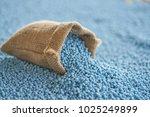 chemical fertilizer in gunny sack and blur background. NPK  fertilizer for plants.  - stock photo