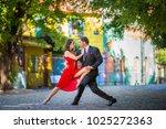 argentine tango couple posing | Shutterstock . vector #1025272363