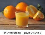glass with fresh orange juice...   Shutterstock . vector #1025291458
