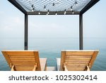 two beach chairs on the terrace | Shutterstock . vector #1025302414