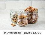 Nut Mix In Glass Jars  Walnuts...