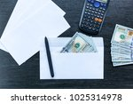 white envelopes with money lie... | Shutterstock . vector #1025314978