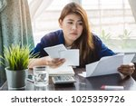 stressed young asian woman... | Shutterstock . vector #1025359726