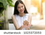 beautiful woman holding a small ... | Shutterstock . vector #1025372053