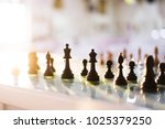 chess figures on bar table | Shutterstock . vector #1025379250