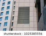 facade building with vertical... | Shutterstock . vector #1025385556