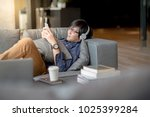young asian man using... | Shutterstock . vector #1025399284