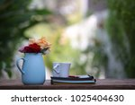 colorful roses in blue pot with ... | Shutterstock . vector #1025404630