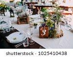 centerpiece on wedding table...   Shutterstock . vector #1025410438
