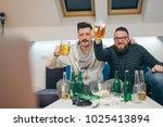 friends watching sport on tv at ... | Shutterstock . vector #1025413894