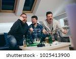 group of friends watching sport ... | Shutterstock . vector #1025413900
