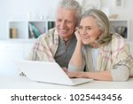 beautiful senior couple with... | Shutterstock . vector #1025443456