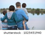 happy family near lake | Shutterstock . vector #1025451940