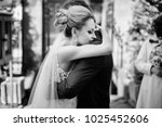 stylish bride and groom gently... | Shutterstock . vector #1025452606