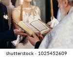 priest holding gospel. stylish... | Shutterstock . vector #1025452609