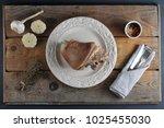 pork leg ham on the plate on a...   Shutterstock . vector #1025455030