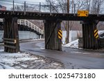 railroad bridge in winter... | Shutterstock . vector #1025473180