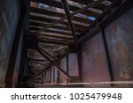 underneath inside railroad... | Shutterstock . vector #1025479948