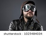 Small photo of Wartime, recreation of the Second World War, old airplane pilot with brown leather jacket, cap of avidor and large glasses