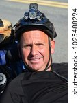 Small photo of KERN COUNTY, CA - FEBRUARY 11, 2018: William Galloway, known as Bicycle Bill, a victim of a car bike crash is criss-crossing the USA on his trike as an advocate for head trauma research and treatment.