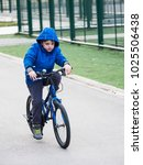 little boy riding a bicycle a... | Shutterstock . vector #1025506438
