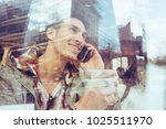 smiling guy calling friends by... | Shutterstock . vector #1025511970